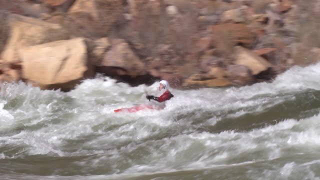 WS TS PAN ZI ZO Man in red kayak floating on rapid / Grand Canyon , Arizona, USA