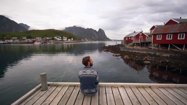 man in reine village in lofoten islands - cottage stock videos & royalty-free footage