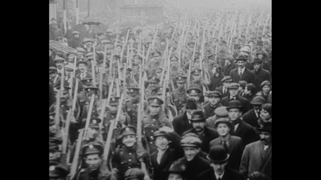 man in robes and turban with british prime minister david lloyd george / mls high angle view of soldiers marching thru crowd toward and beneath... - 1910 1919 stock videos & royalty-free footage