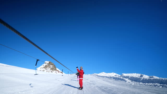 man in santa costume traveling on ski lift - seggiovia video stock e b–roll