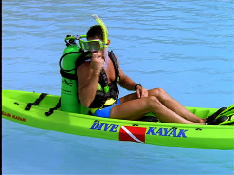 man in scuba gear rolls into water from kayak / cancun - tauchgerät stock-videos und b-roll-filmmaterial