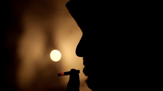 man in shadow - smoking issues stock videos & royalty-free footage