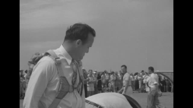 man in shirt and tie and parachute assembly climbs into cockpit of glider as crowd looks on / note: exact year not known - shirt and tie stock videos & royalty-free footage