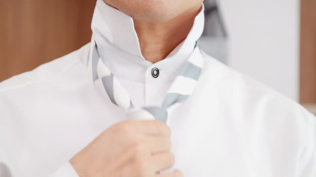 man in shirt dressing up and adjusting tie on neck at home.businessman tying necktie - necktie stock videos & royalty-free footage