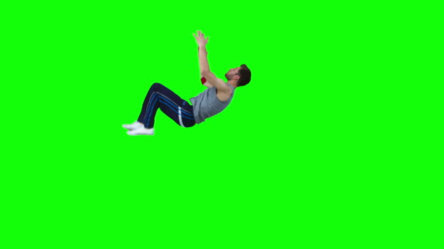 man in slow motion performing a backflip - green background stock videos & royalty-free footage