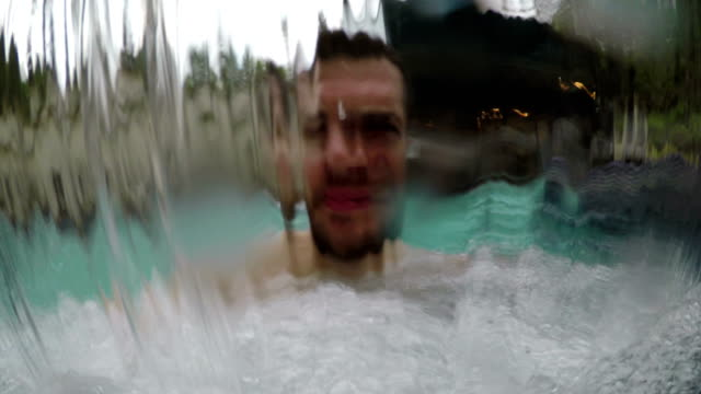 man in spa waterfall enjoys - turquoise colored stock videos & royalty-free footage