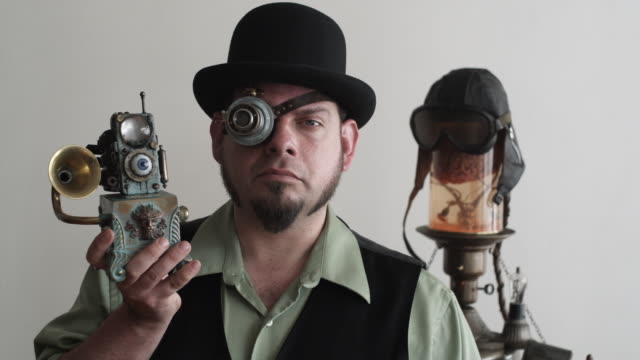 ms man in steampunk outfit holding up victorian eye pod, middletown, connecticut, usa - ziegenbart stock-videos und b-roll-filmmaterial
