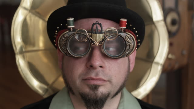 cu man in steampunk outfit with bizarre sewing goggles, middletown, connecticut, usa - ziegenbart stock-videos und b-roll-filmmaterial