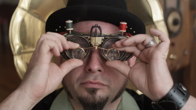 CU Man in Steampunk outfit with bizarre sewing goggles, Middletown, Connecticut, USA