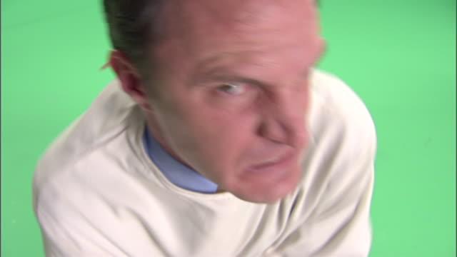 CU, HA, Man in straitjacket in studio