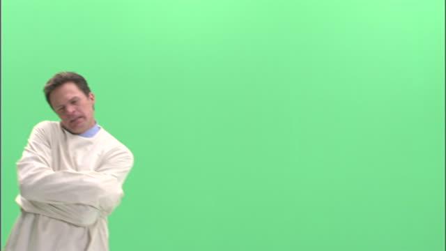 MS, Man in straitjacket jumping in studio