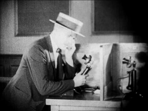 b/w 1929 man in straw hat talking on telephone / newsreel - straw hat stock videos & royalty-free footage