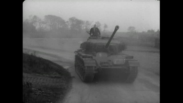man in suit and tie drives tank; 1956 - british military stock videos & royalty-free footage