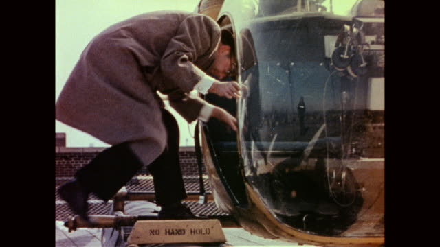 man in suit climbs into helicopter man getting into helicopter on january 01 1958 in new york new york - anno 1958 video stock e b–roll