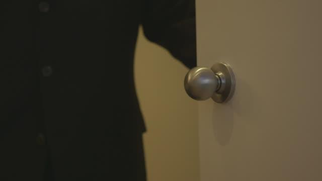 man in suit closes and opens door - door to door salesperson stock videos & royalty-free footage