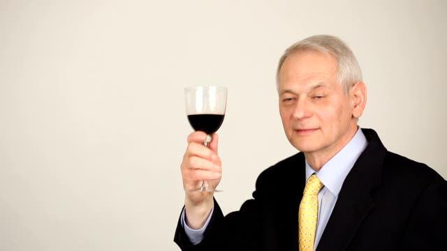 man in suit facing camera, toasting with wine nodding approval - shirt and tie stock videos & royalty-free footage