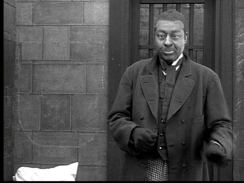 1916 b&w ms man in suit in prison cell pretending to deal cards  - dealing cards stock videos and b-roll footage