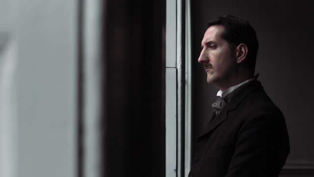 man in suit looking out of window - late 1800s era reenactment . - staring stock videos & royalty-free footage