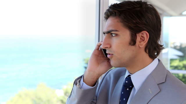 Man in suit on his mobile phone
