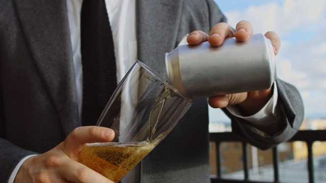 man in suit pouring beer - pouring stock videos & royalty-free footage