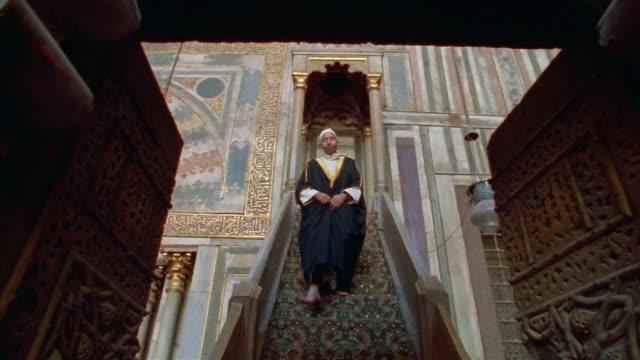 ms, pan, man in sultan hassan mosque, cairo, egypt - arabic script stock-videos und b-roll-filmmaterial