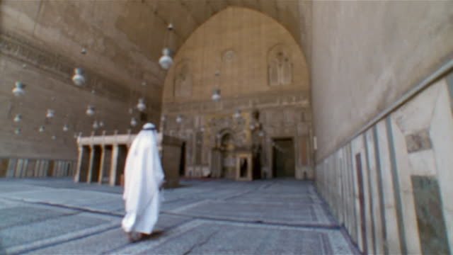 ms, pan, defocus, man in sultan hassan mosque, rear view, cairo, egypt - madressa stock videos and b-roll footage