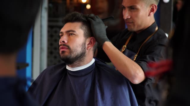 man in the barber shop - barber chair stock videos & royalty-free footage