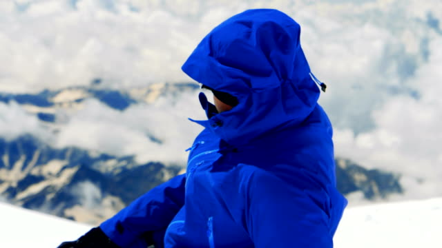man in the mountains. climber resting on the mountain top - jacket stock videos & royalty-free footage