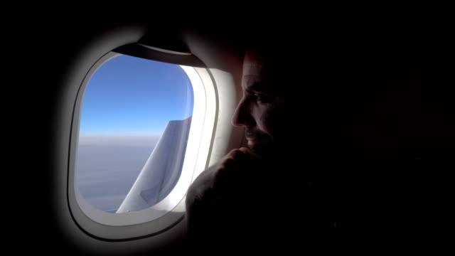 man in the plane - looking through window stock videos & royalty-free footage