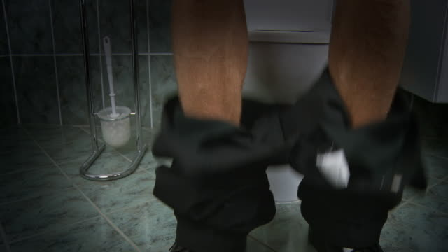 hd: man in the toilet room - pants stock videos and b-roll footage