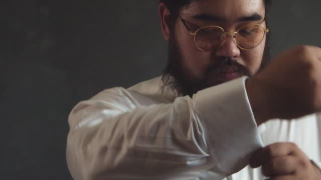 man in the white shirt dress cufflinks. - cufflink stock videos & royalty-free footage