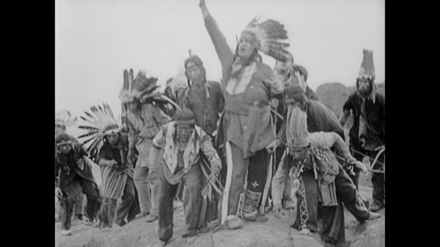 1922 man (buster keaton) in top hat and tails hides in teepee to escape american indians - native american reservation stock videos & royalty-free footage