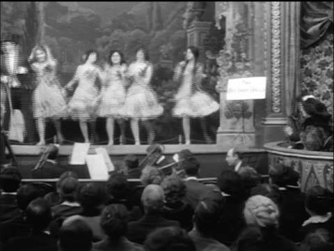 b/w 1914 man in top hat performing as chorus line dances in theater - performing arts event stock videos & royalty-free footage