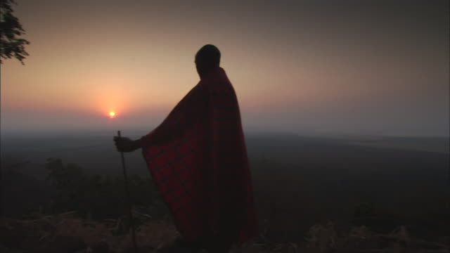 MS PAN Man in traditional African Massai and sunset / Kigoma, Tanzania