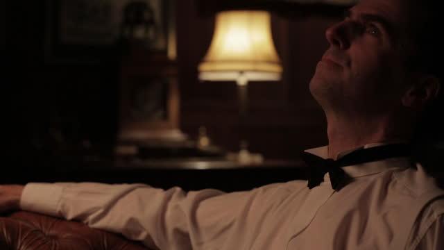 man in tuxedo waiting on sofa - 1930s era reenactment - dinner jacket stock videos & royalty-free footage