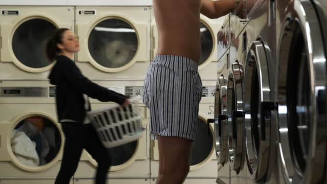 man in underwear at laundromat