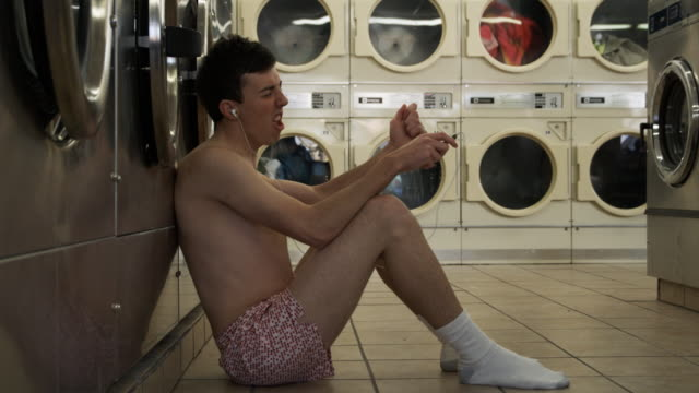 man in underwear at laundromat - early rock & roll stock videos & royalty-free footage