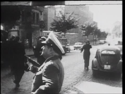 man in uniform holding gun standing in street looking up / west berlin / germany - documentary footage stock videos & royalty-free footage