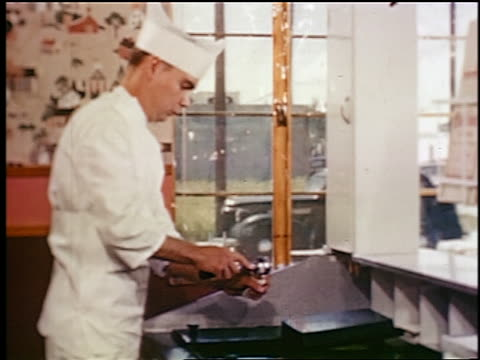 1948 profile man in uniform putting scoop of ice cream on cone in ice cream store / industrial - ice cream cone stock videos & royalty-free footage