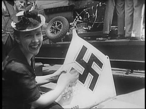 man in uniform stands near nazi messerschmitt plane / shots of men standing near nazi plane swastika on tail / interior views of plane / woman in hat... - uniform stock videos & royalty-free footage