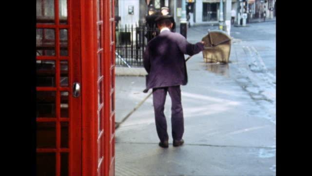 man in uniform sweeps streets in london; 1975 - 1975 stock videos & royalty-free footage
