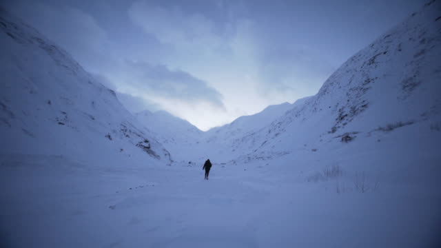 man in valley - rising shot - winter stock videos & royalty-free footage