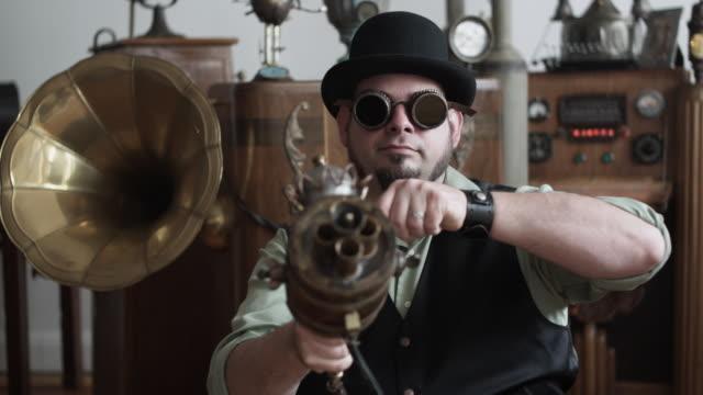 ms man in victorian steampunk outfit pointing victorian futuristic gun at camera, middletown, connecticut, usa - ziegenbart stock-videos und b-roll-filmmaterial