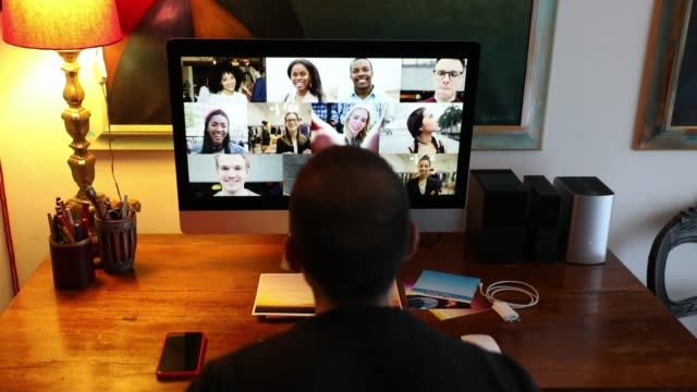Man in Video call with friends and relatives in front of computer