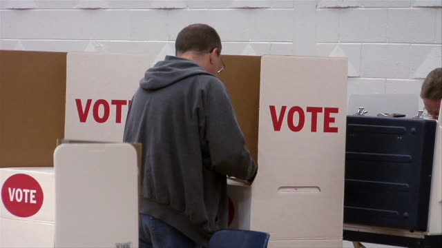 ms, man in voting booth, rear view, ypsilanti, michigan, usa - ypsilanti stock videos & royalty-free footage