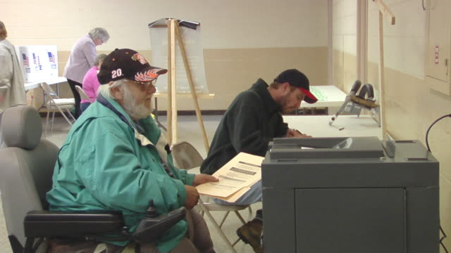 cu, zo, ms, man in wheelchair casting his vote in ballot box then leaving, st. marys, ohio, usa - voting ballot stock videos and b-roll footage