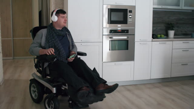 man in wheelchair listening to music - persons with disabilities stock videos & royalty-free footage