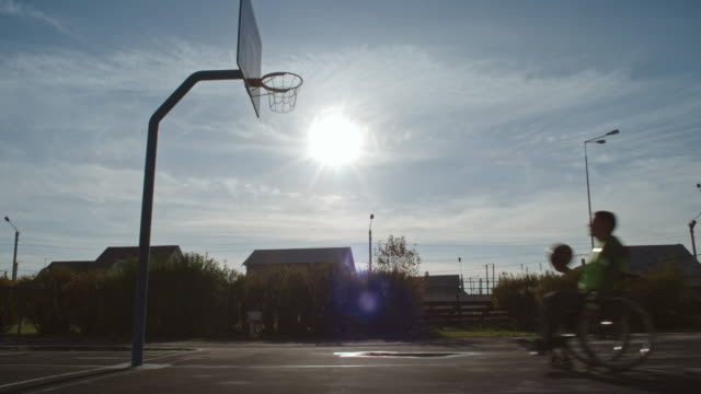 man in wheelchair scoring points on basketball court - adaptive athlete stock videos and b-roll footage