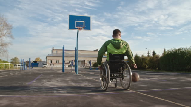 man in wheelchair shooting basketball and missing hoop - wheelchair basketball stock videos and b-roll footage