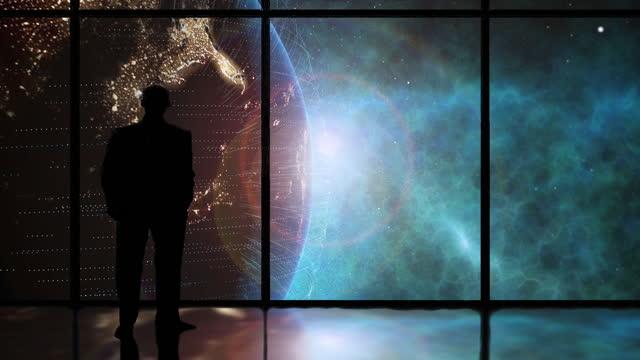 vidéos et rushes de homme dans la fenêtre regardant la terre de l'espace - silhouette contre jour